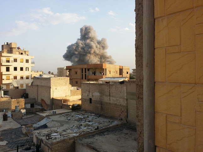 Smoke rises after air strikes by Syrian army warplanes on the ISIS-held northern city of Raqqa, Syria