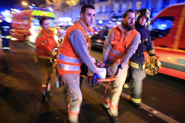 Emergency responders help victims at the Bataclan