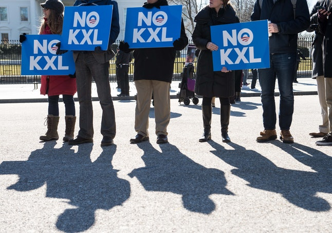 Protesters standing against the proposed Keystone XL pipeline in Washington, D.C.