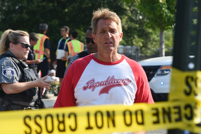 Sen. Jeff Flake walks toward media gathered at the scene of the shooting at a Virginia baseball practice that left House Majority Whip Steve Scalise wounded in June.