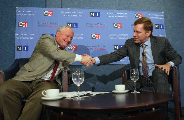 The Weekly Standard Editor William Kristol shakes hands with PayPal co-founder and former CEO Peter Thiel after a discussion.