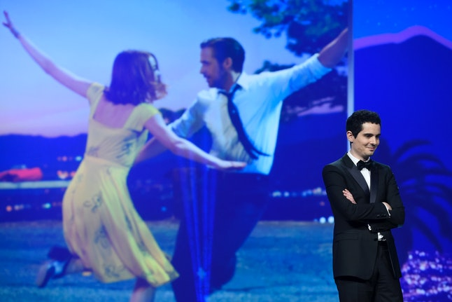 """Damien Chazelle is seen on stage before accepting the Vanguard award for """"La La Land"""" at the 28th annual Palm Springs International Film Festival Awards Gala on Monday, Jan. 2, 2017, in Palm Springs, California."""