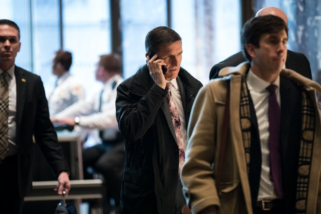 Michael Flynn talks on his cell phone as he arrives at Trump Tower in January.