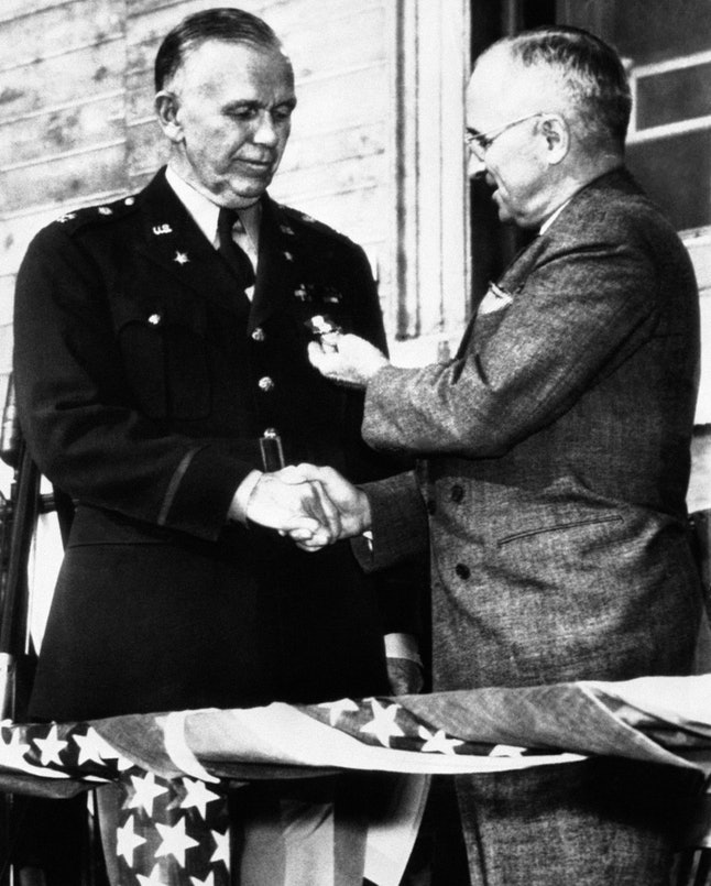 President Harry S. Truman, right, congratulates then-U.S. Army General George C. Marshall in a November 1945 ceremony.