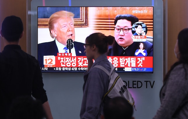 Television screens at a railway station in Seoul show President Donald Trump and North Korean leader Kim Jong Un.