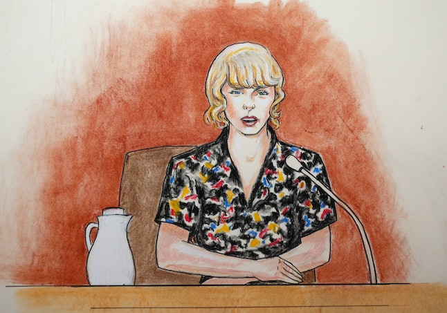 In this courtroom sketch, pop singer Taylor Swift speaks from the witness stand during a trial in Denver.