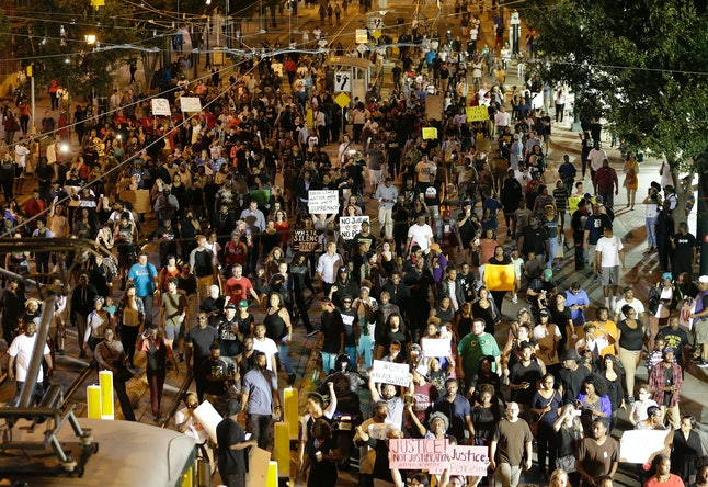 Protesters march in downtown Charlotte, North Carolina, over the police shooting death of Keith Lamont Scott.
