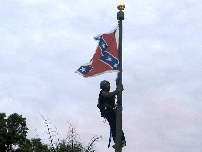 Bree Newsome removes Confederate flag from flagpole outside of South Carolina state capitol building.