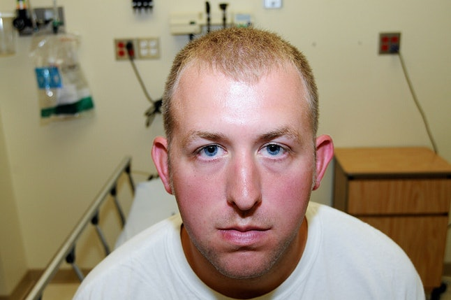 Former Ferguson, Missouri, police officer Darren Wilson poses in an evidence photo at the hospital, on the same day that he fatally shot Mike Brown in 2014.