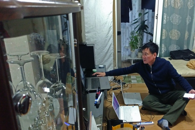 Inside his Seoul apartment, Jung shows videos he loads onto USB drives and sends to North Korea, on Nov. 18.