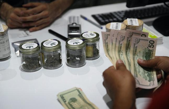 A person buys marijuana at the Essence cannabis dispensary, Saturday, July 1 in Las Vegas.