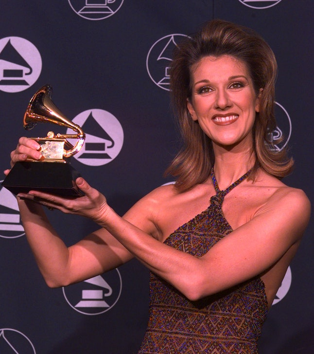 Céline Dion holds up at the 39th Annual Grammy Awards in New York City, Wednesday, Feb. 26, 1997.