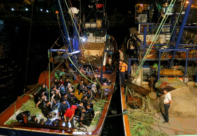 A fishing boat named Gencay 3 rescues nearly 49 Syrian refugees who were trying to reach Greece in Aegean Sea in Izmir, western Turkey on Aug. 31.