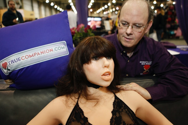 True Companion founder Douglas Hines poses with his sex robot, Roxxxy, at the Adult Entertainment Expo in 2010.