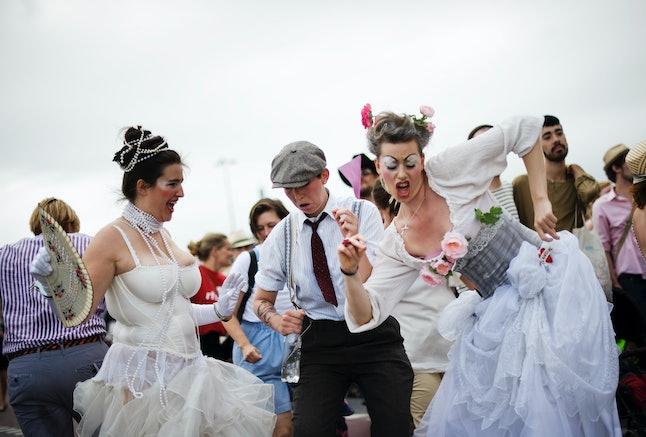 "People dancing during 2011's ""Stockholm Pride"" parade."