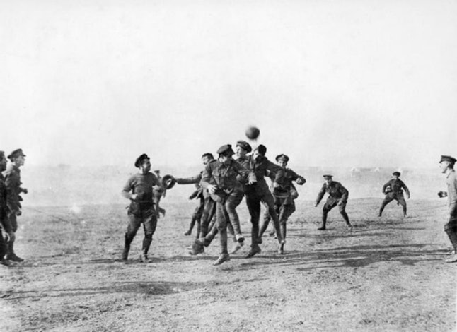 British and Germans soldiers play soccer on the Western Front on Christmas Day, 1914.