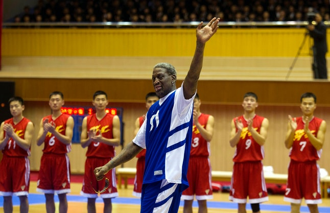 "FILE - In this Jan. 8, 2014 file photo, former NBA star Dennis Rodman waves at North Korean leader Kim Jong Un, seated above in the stands, after singing ""Happy Birthday"" to him before an exhibition basketball game at an indoor stadium in Pyongyang, North Korea."