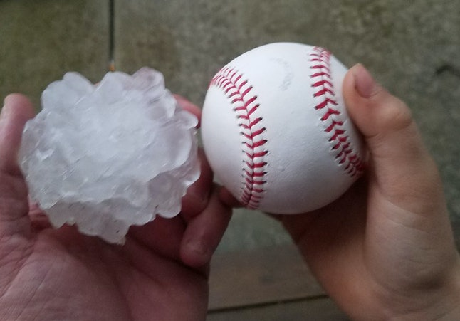 A hailstone that fell in Ottawa, Illinois, along with a baseball for comparison
