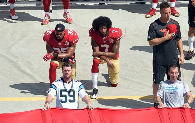 Kaepernick kneeling during the national anthem before a recent game.