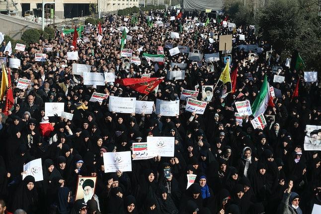 Iranian protesters chant slogans at a rally Saturday in Tehran, Iran.