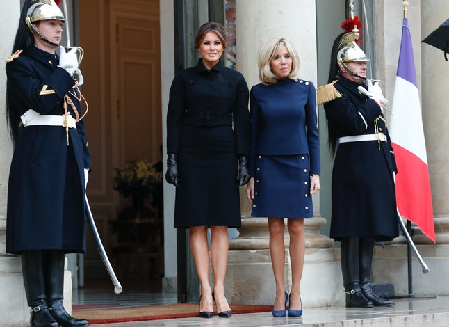 French President Emmanuel Macron's wife, Brigitte Macron, and first lady Melania Trump pose at the Élysée Palace in Paris.