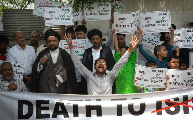 Demonstrators protest in New Delhi, India, after the Islamic State claimed a pair of attacks on Iran's parliament in June.