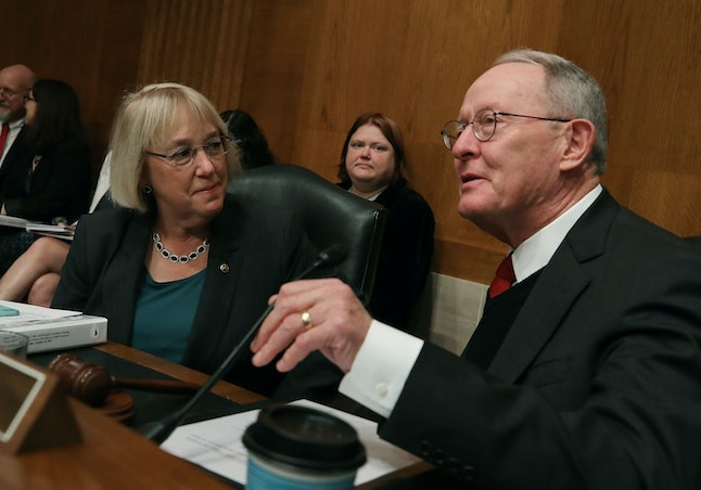 Chairman Lamar Alexander and ranking member Sen. Patty Murray confer during a Senate Health, Education, Labor and Pensions committee hearing on Capitol Hill.