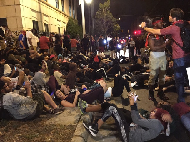 Protesters in Charlotte, North Carolina, lie down in the street in front of the police department.
