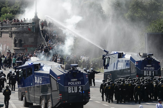 Police use a water cannon to clear a road on the first day of the G20 summit in Hamburg, Germany on July 7.