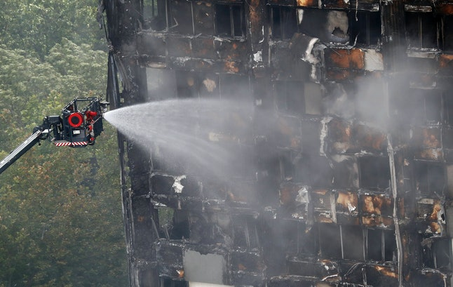 A remote firefighting platform continued to douse the deadly fire at Grenfell Tower in London on Thursday.
