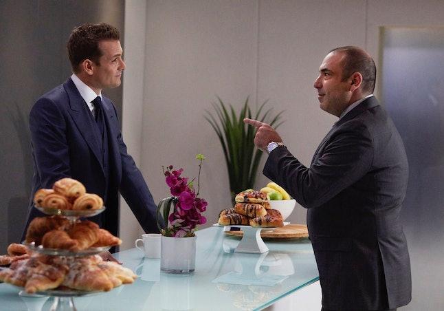 Gabriel Macht as Harvey Specter and Rick Hoffman as Louis Litt