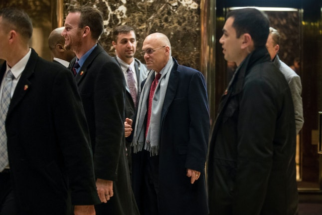 Andrew Puzder, pictured center, is the CEO of CKE Restaurants. During Puzder's tenure, the company was hit with more labor violations than any other burger chain.