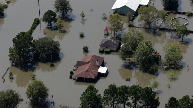 Homes are surrounded by floodwaters in the aftermath of Hurricane Harvey near Beaumont, Texas.