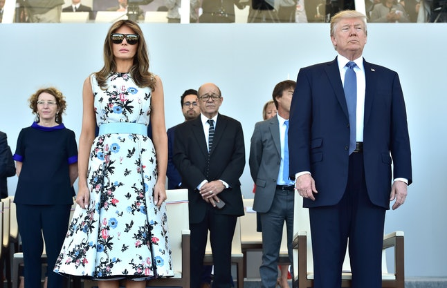 Melania Trump (left) and Melania Trump's husband (right) at the Bastille Day military parade in Paris
