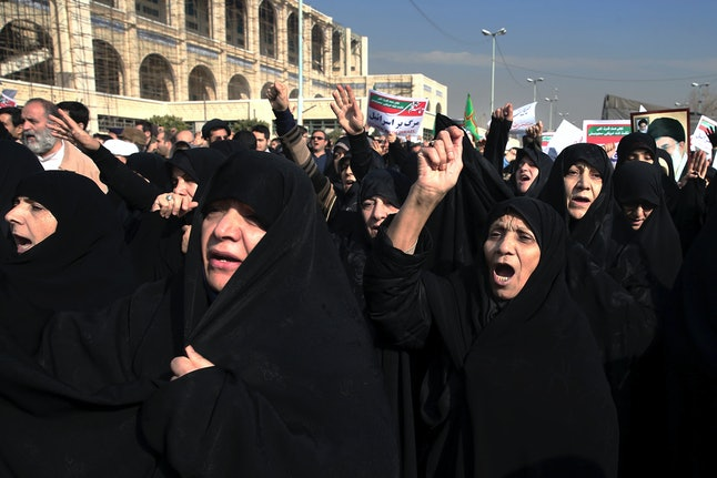 Iranian protesters chant slogans at a rally in Tehran, Iran, on Saturday.