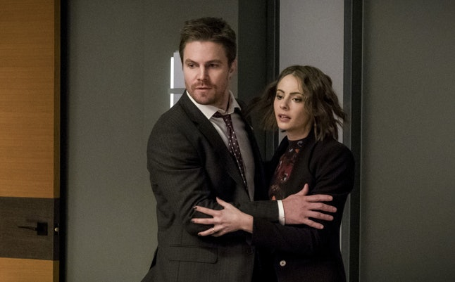Stephen Amell as Oliver Queen and Willa Holland as Thea Queen