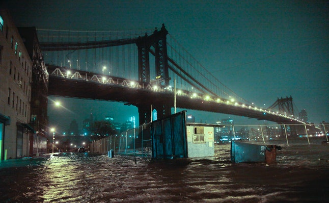 In this Oct. 29, 2012, file photo, the streets under the Manhattan Bridge in the Brooklyn borough of New York are flooded as Superstorm Sandy hit the city.