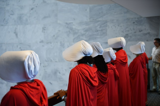 Women dressed as characters from the novel-turned-TV series 'The Handmaid's Tale' line up before Supreme Court nominee Brett Kavanaugh's first day of confirmation hearings in front of the U.S. Senate on Capitol Hill in Washington, D.C., on Sept. 4.