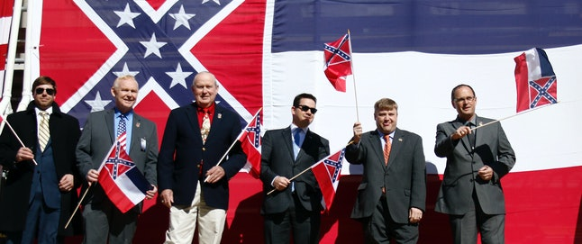 Mississippi state legislators who support the flag pose at a rally held by the Sons of Confederate Veterans. The state's governor is a dues-paying member.