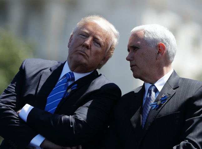 President Donald Trump talks with Vice President Mike Pence before speaking at the 36th Annual National Peace Officers' memorial service.