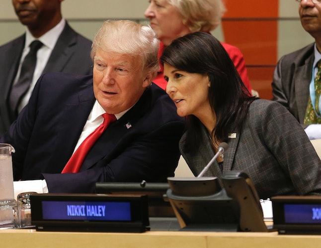 President Donald Trump speaks with U.S. Ambassador to the United Nations Nikki Haley.