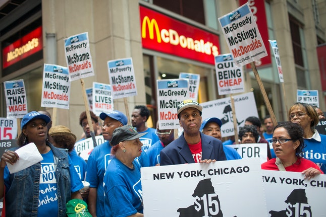 Activists protest outside a McDonald's location in Chicago, Illinois in June 2015.