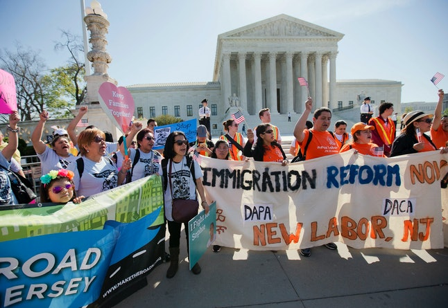 Immigration reform advocates protesting outside of the Supreme Court on Monday.
