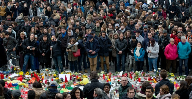 People observe a moment of silence to honor the Brussels victims.
