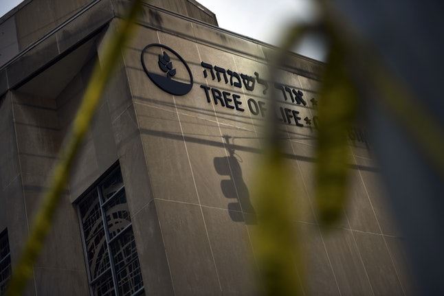 Police tape is seen on Oct. 28 outside the Tree of Life synagogue after a shooting there left 11 people dead in the Squirrel Hill neighborhood of Pittsburgh on Oct. 27.