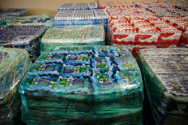 Cases of bottled water at a fire station in Flint.