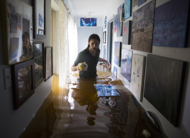 Matthew Koser inside his grandfather's house after it was flooded by heavy rains from Hurricane Harvey in the Bear Creek neighborhood of west Houston, Texas, on Aug. 29.