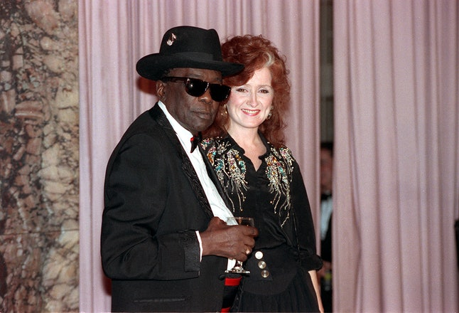 Blues guitarist John Lee Hooker and singer Bonnie Raitt at the Rock and Roll Hall of Fame induction dinner in New York City on Wednesday, Jan. 17, 1991.