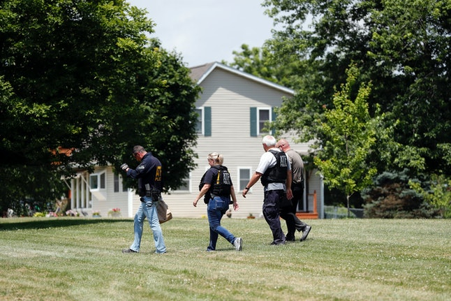 Law enforcement investigates outside the home of James T. Hodgkinson in Bellleville, Illinois.