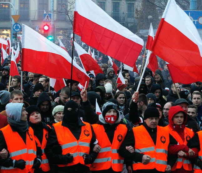 Demonstrators wave Polish flags during the annual march to commemorate Poland's National Independence Day in Warsaw, Poland, on Nov. 11.